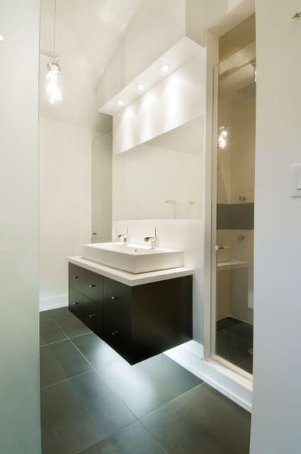 C) Floating Vanity With Under Cabinet Lighting